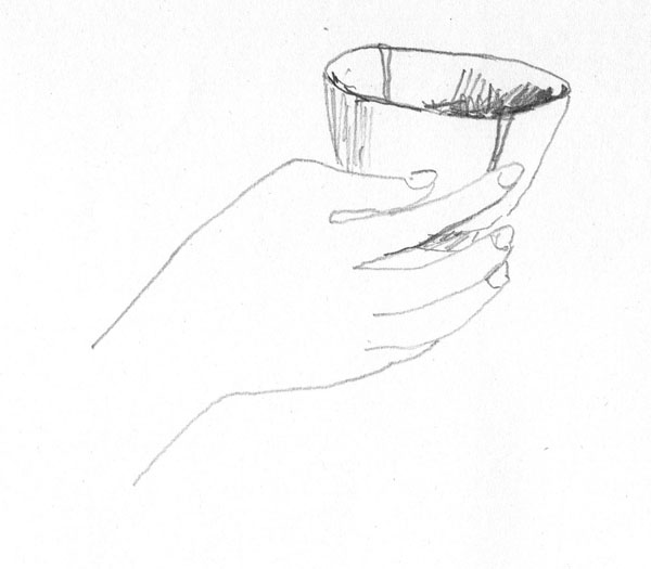 白い湯呑の器を持つ手